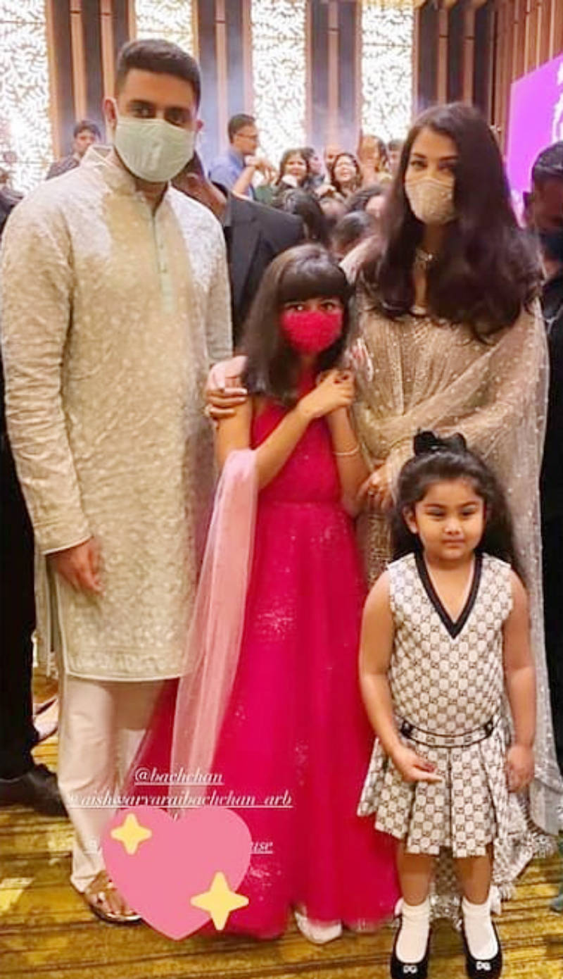 Aishwarya Rai & Abhishek Bachchan attend a family wedding with Aaradhya