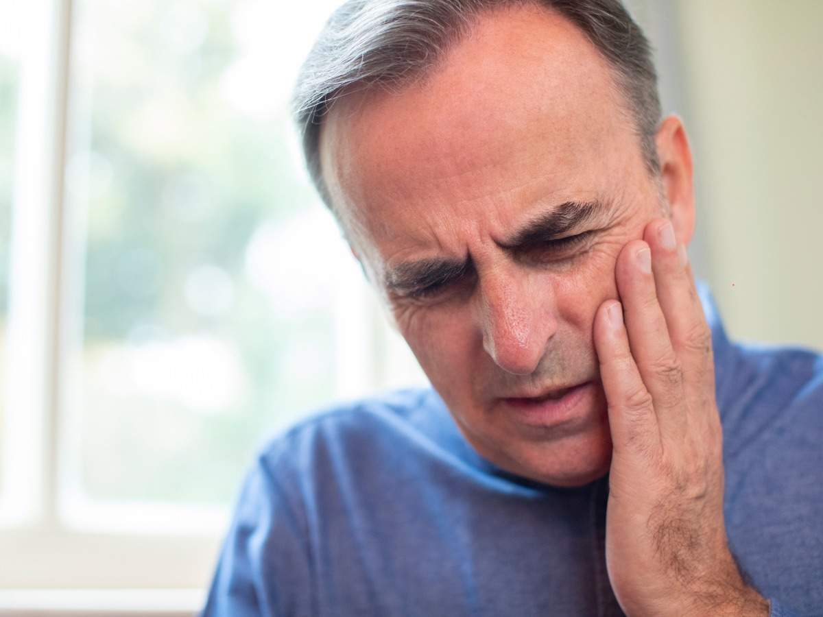 Coronavirus symptoms: Signs you are suffering from COVID-tongue and how to identify them - Times of India