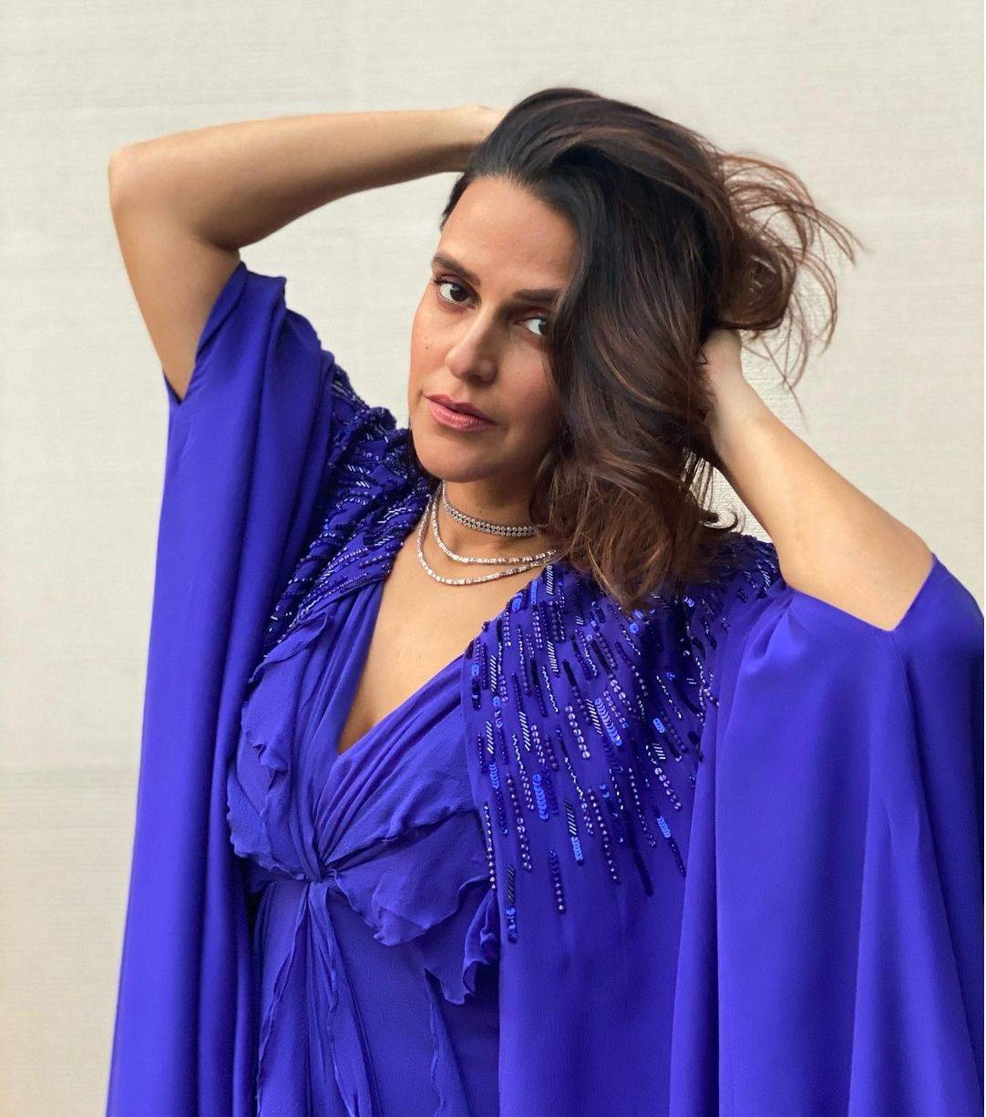 Neha Dhupia sets the internet on fire in an electric blue cape dress
