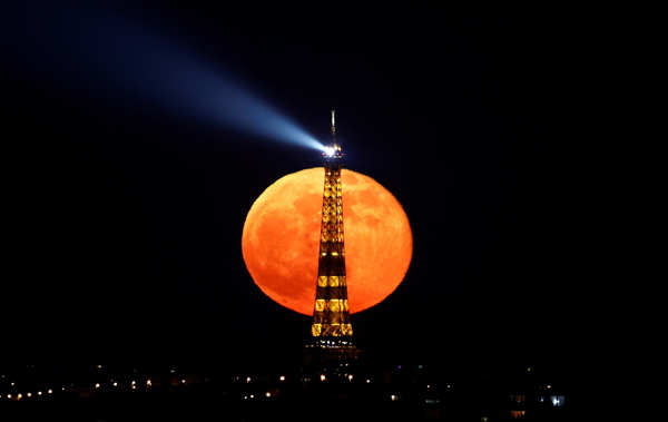 Spectacular pictures of 'pink' supermoon across the world