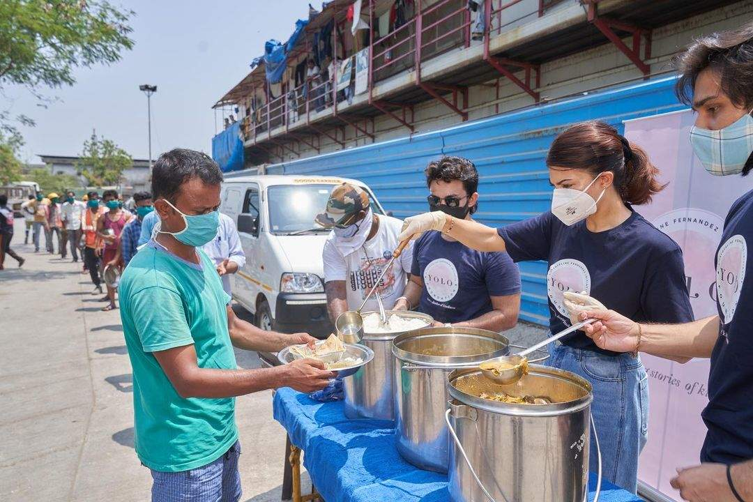 Jacqueline Fernandez serves meals to the ones affected by crippling COVID