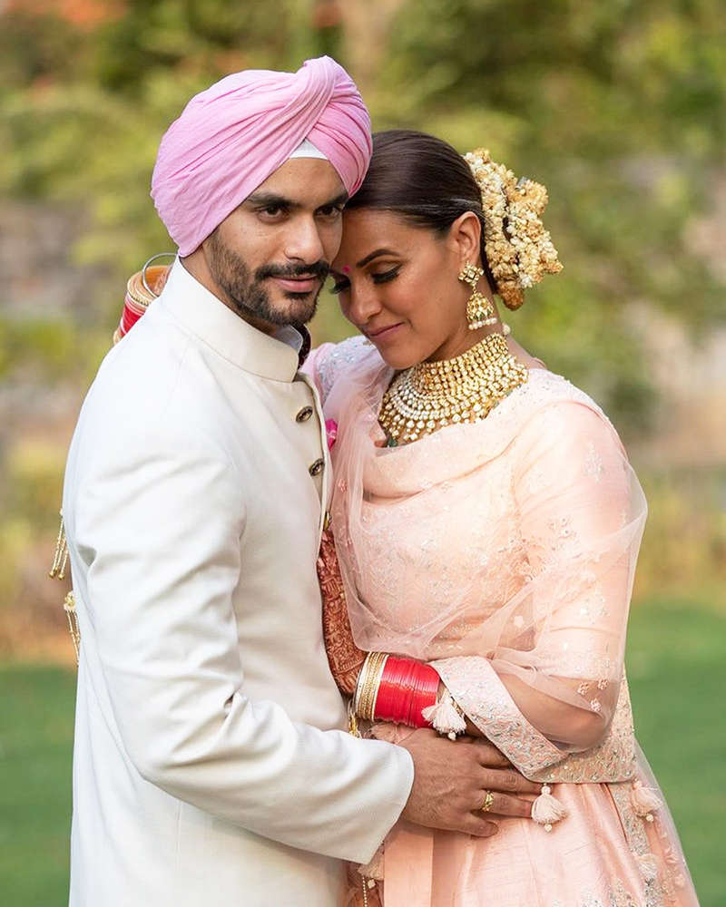 Mommy-to-be Neha Dhupia flaunts her baby bump in these new pictures