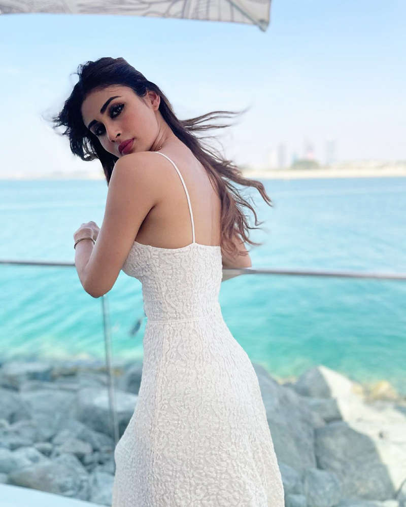 Mouni Roy stuns in a strappy white dress in these dreamy vacation pictures