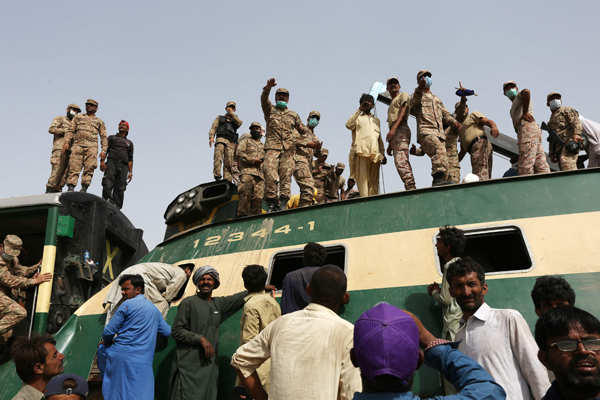 At least 65 killed as passenger trains collide in Pakistan