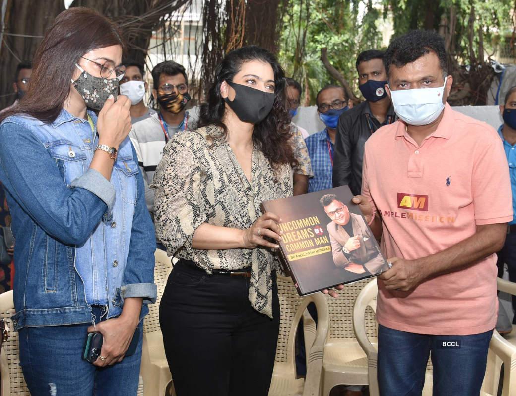 Bollywood actress Kajol distributes raincoats to BMC employees