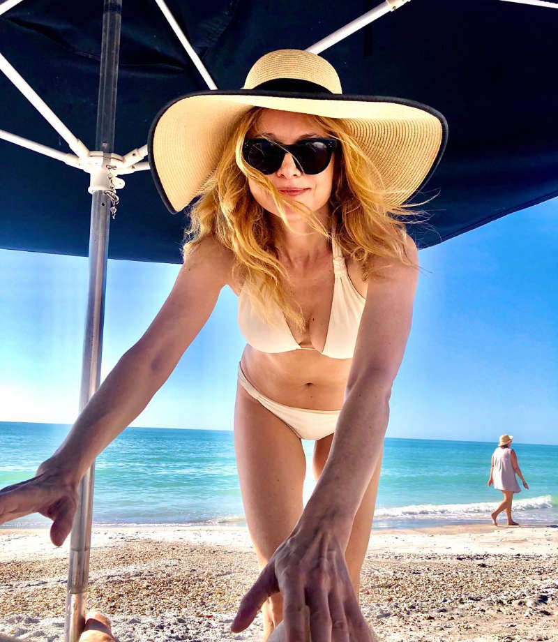 Vacation pictures of Heather Graham will make you hit the beach!