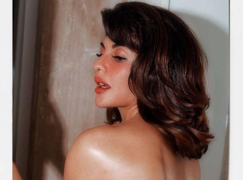 Jacqueline Fernandez looks drop dead gorgeous wrapped in an orange towel