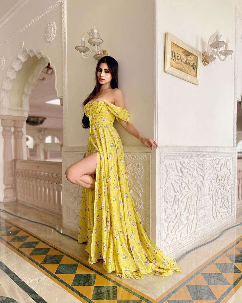Mouni Roy is making heads turn with her stunning pictures in thigh-high slit yellow floral dress