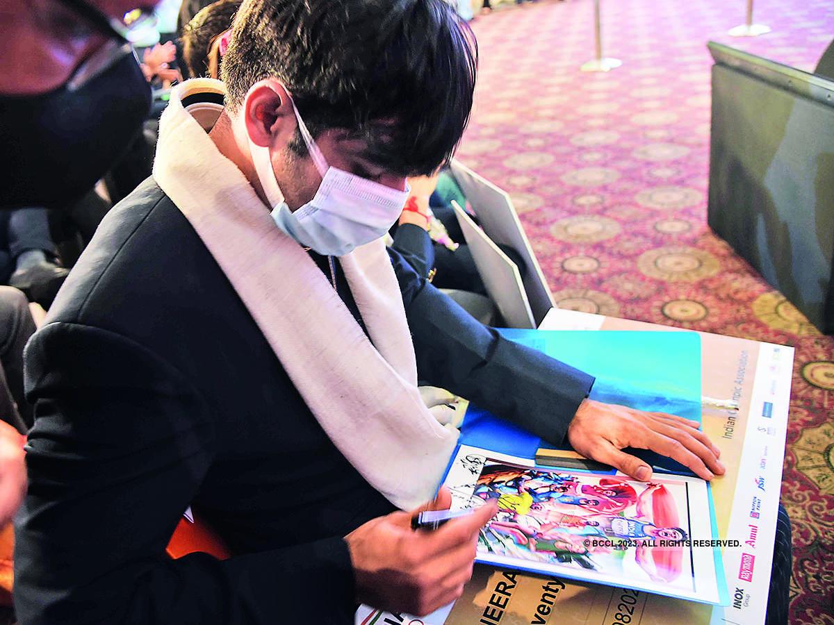 Neeraj Chopra signing an autograph