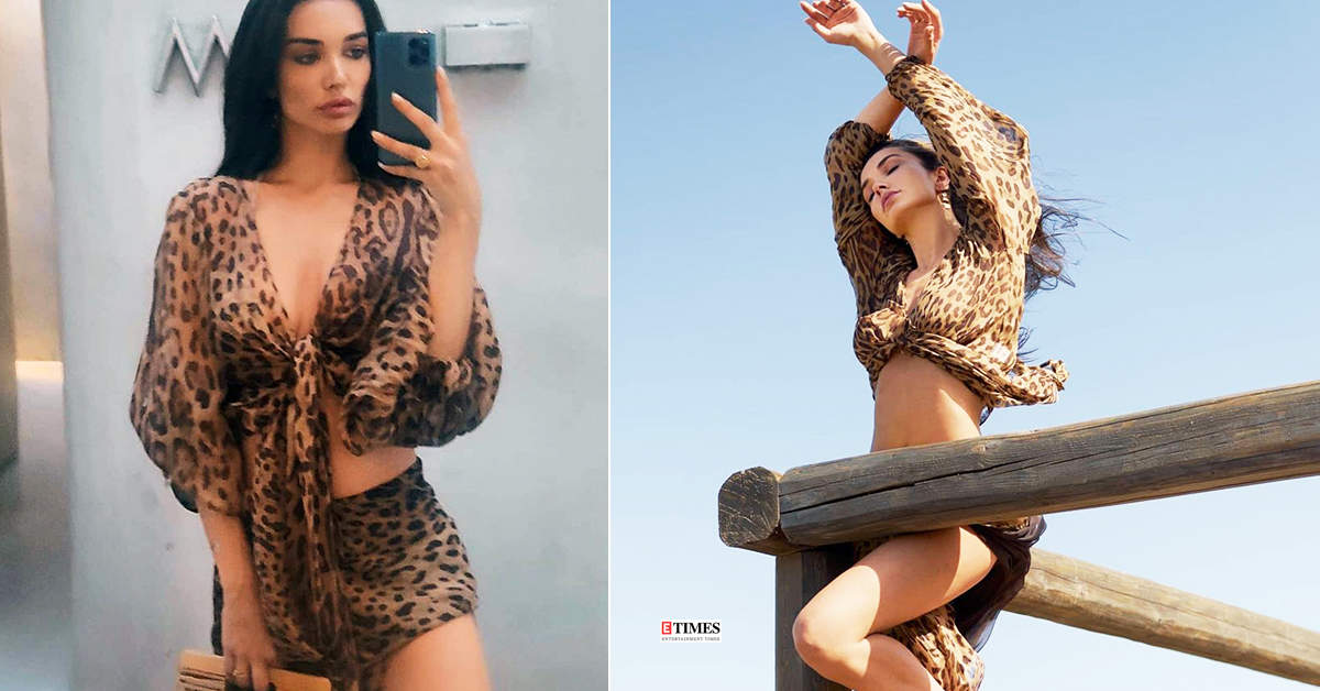 After breakup rumours with fiancé George Panayiotou, Amy Jackson turns heads in stylish leopard print beachwear