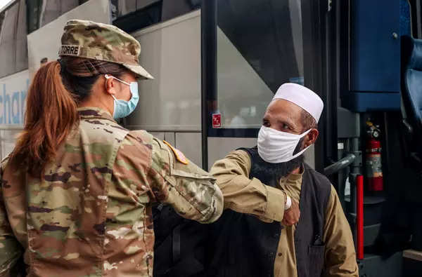 25 pictures of evacuated Afghans who arrived in US
