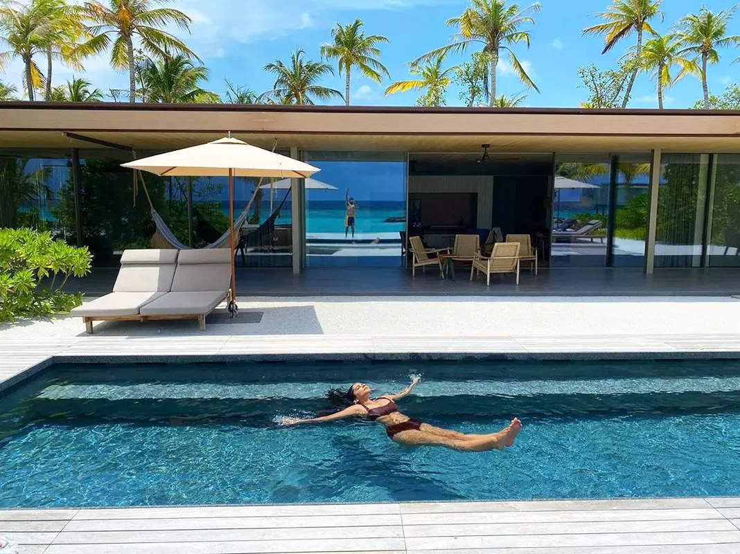 This picture of newly-wed Rhea Kapoor lounging in a pool will fill you with wanderlust