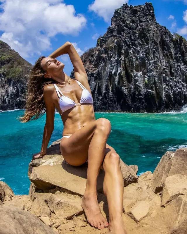 From Kim Kardashian to Jennifer Lopez, photos of Hollywood stars who slayed in white bikinis and swimsuits