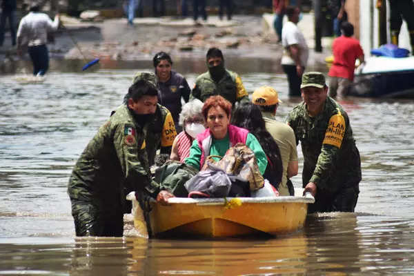 Photos: Floods, earthquake leave trail of destruction in Mexico