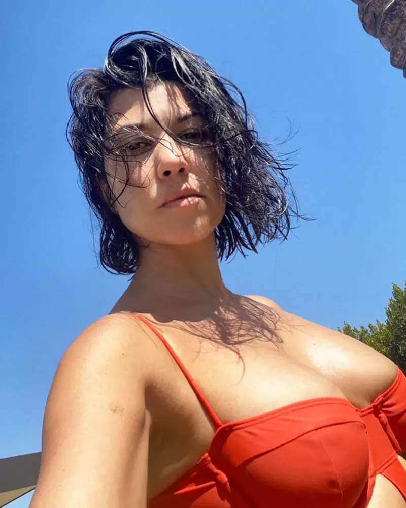 Kourtney Kardashian is raising temperatures with her sultry pictures in orange swimsuit