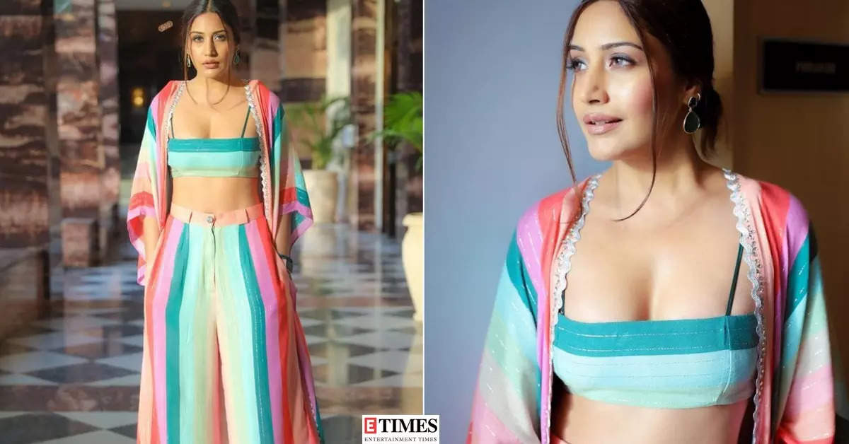 Surbhi Chandna looks sensational in a candy-hued bralette top, flared pants and oversized shrug, pictures will leave you speechless!