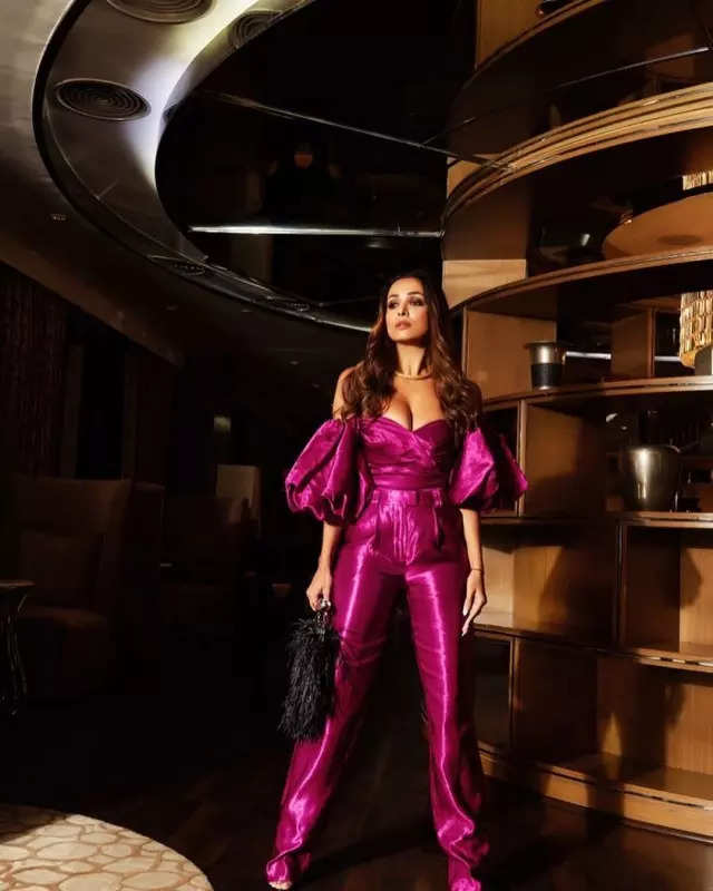 Malaika Arora exudes oomph in a bright metallic purple jumpsuit, stylish photos will make you go gaga over her look!