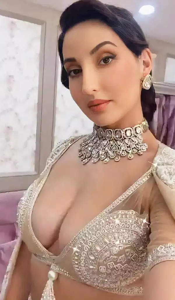 New pictures of Nora Fatehi in a thigh-high slit lehenga with a plunging neckline bralette prove she is effortlessly glamorous