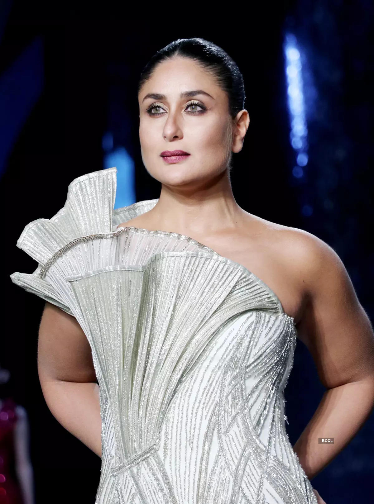 Bollywood celebrities showcase designer outfits at a fashion show
