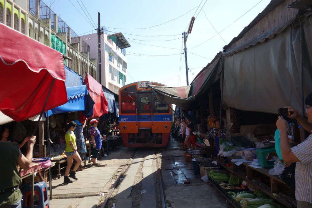 Maeklong Railway Market: a marketplace with a railway track through it