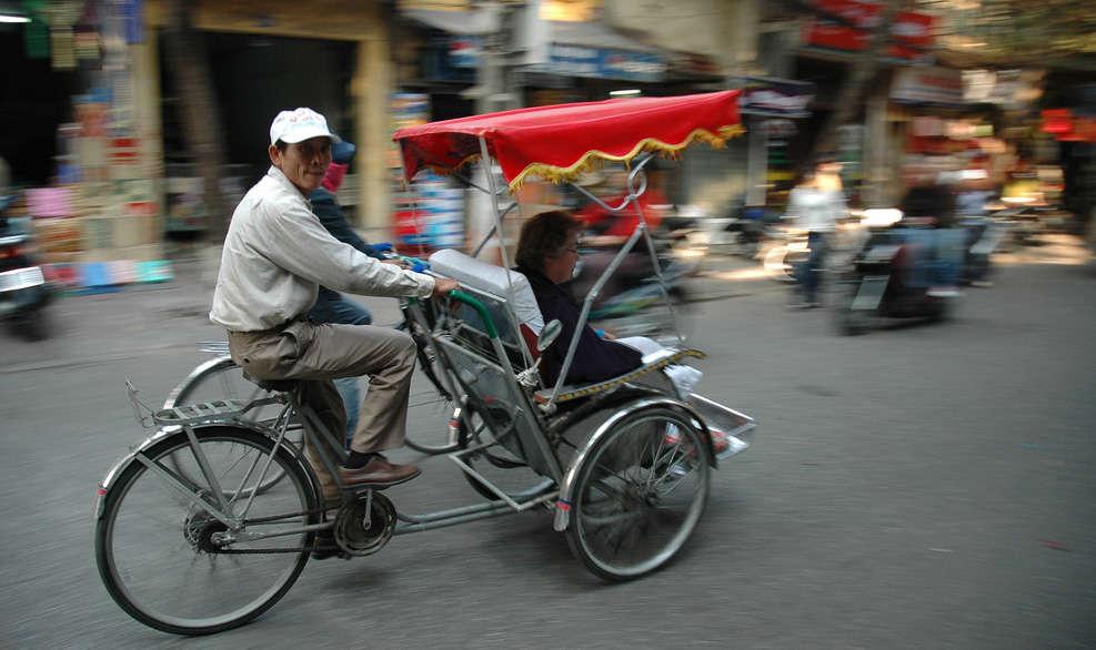 Xích lô (cyclo) and xe om (moto-taxi)