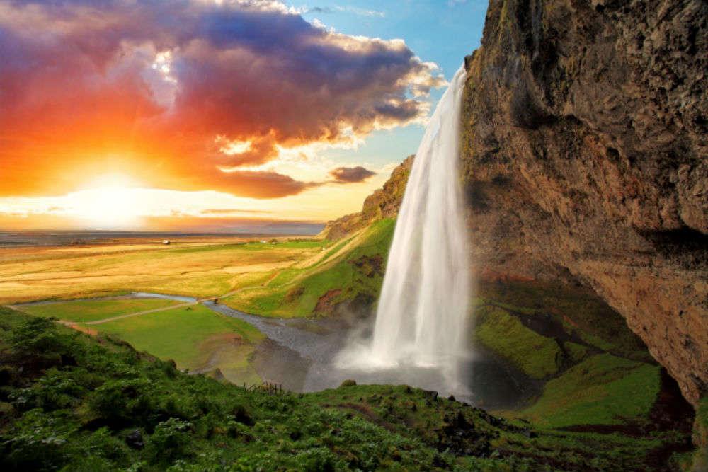 Walk behind Seljalandsfoss waterfall