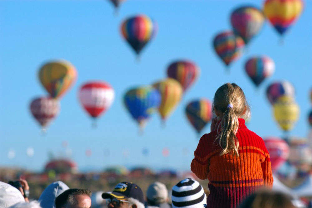Watching hundreds of colorful hot-air balloons ascend into the dawn sky