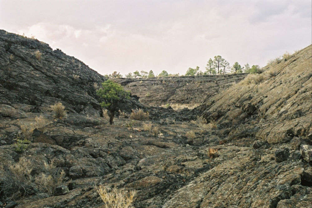 Walking across volcanic badlands in the footsteps of ancient Americans