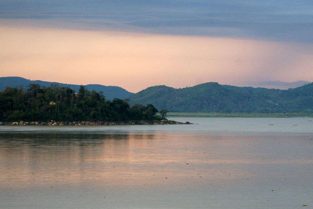 See the sun rise across the Brahmaputra from Fancy Bazaar