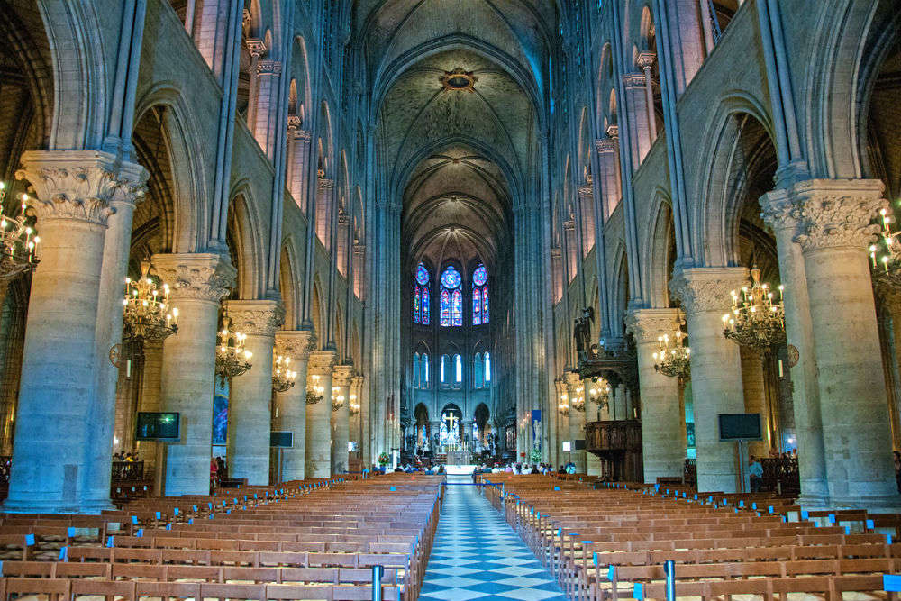 Attend the midnight mass at the Notre Dame Cathedral
