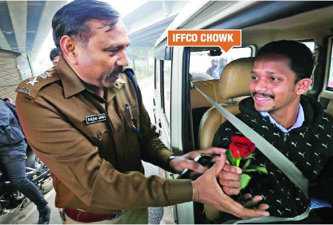 Image result for haryana police give rose and chocolate to broke traffic rules