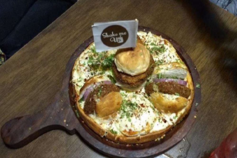 Treat yourself to 'Burger on a Pizza' at Shake Me Up Cafe in Mumbai!