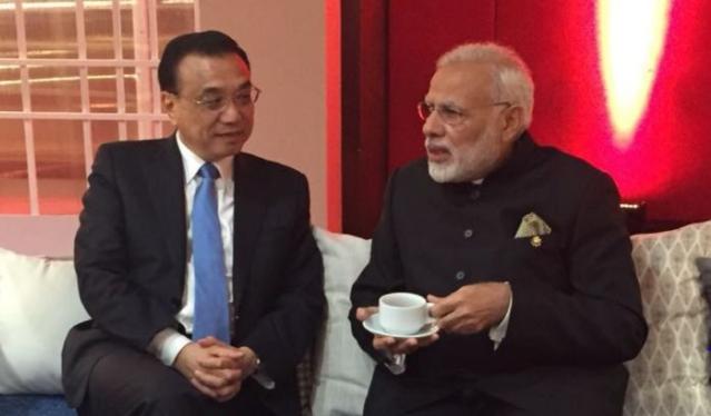 PM Modi, Chinese Premier hold brief interaction in Manila