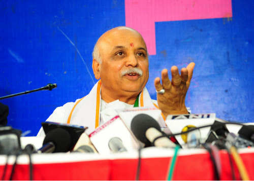 RSS to axe Togadia, 2 others for attacks on govt - Times of India