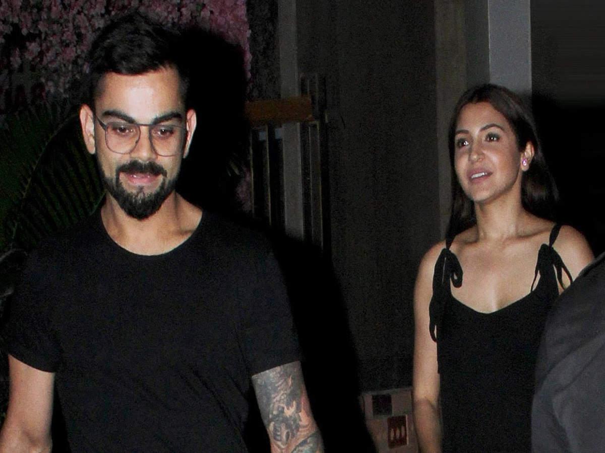 Anushka Sharma and Virat Kohli twin in black on their date night