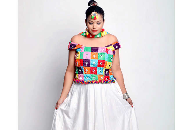 3419ed958d477 From crop tops and cold-shoulder blouses to flared skirts and dhoti ...