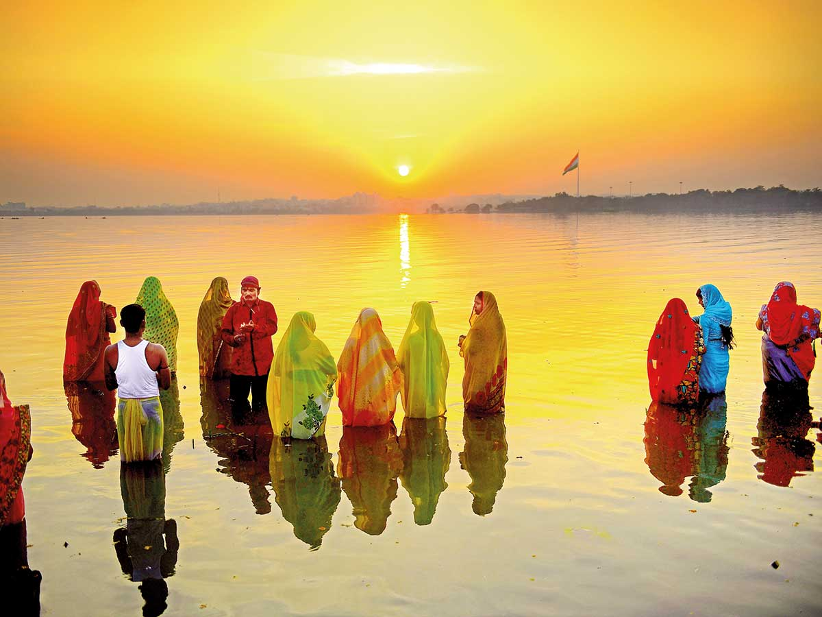 Hussain Sagar dazzles in colors of Chhath Puja