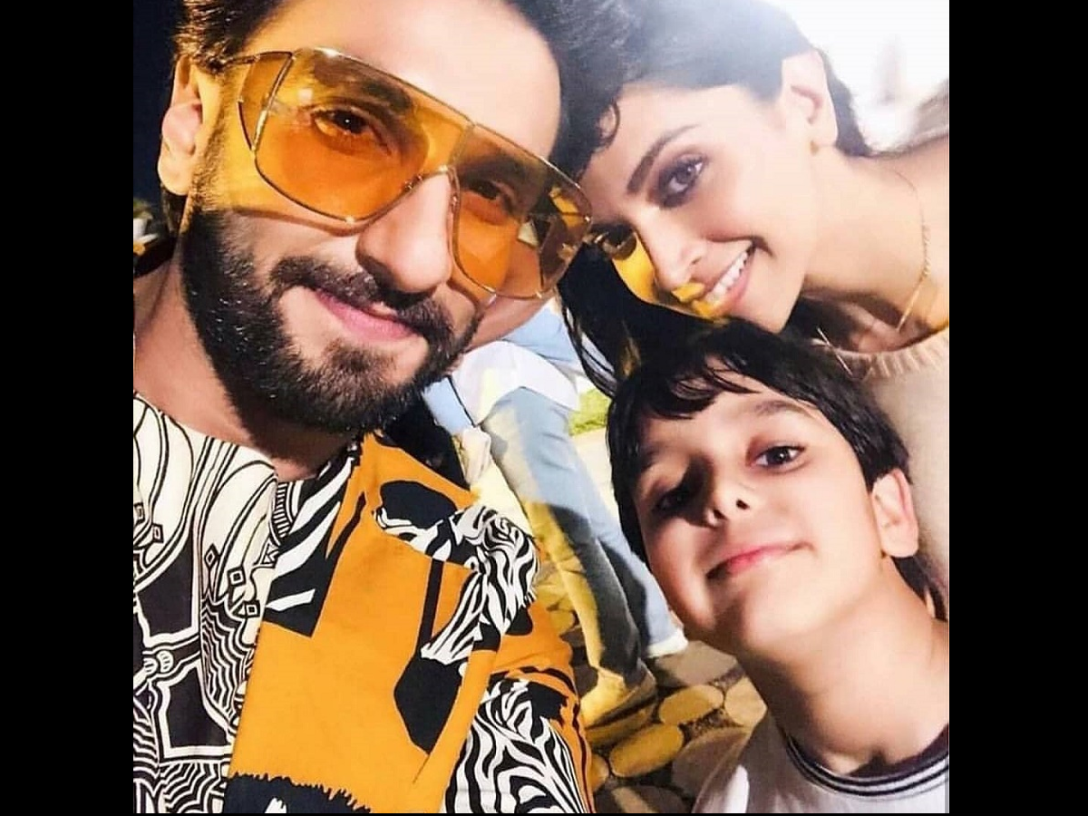 Photo: Ranveer Singh And Deepika Padukone Pose With A Young Fan | Hindi Movie News
