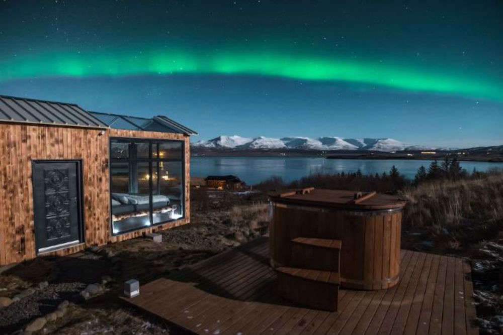 Watch the Northern Lights from your bed at this glass cabin!