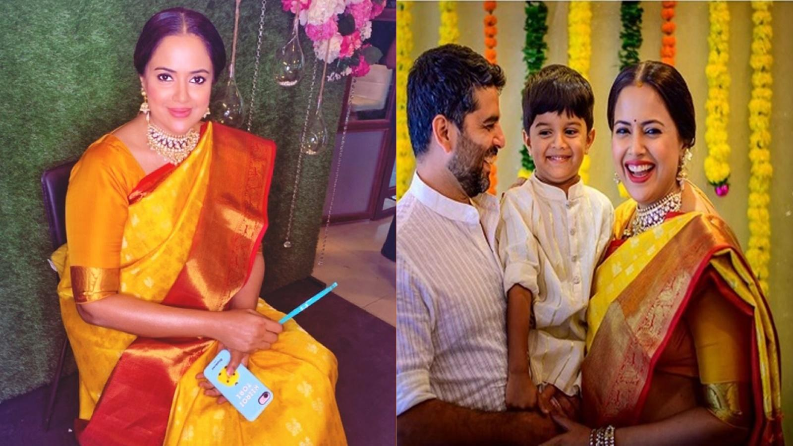 sameera-reddy-celebrates-her-baby-shower-looks-gorgeous-in-traditional-yellow-sari