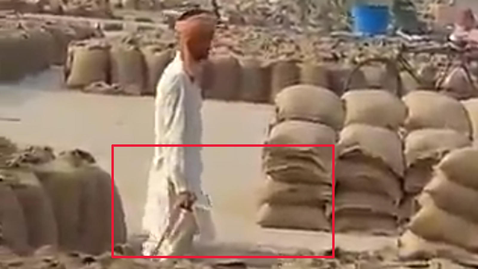 shocking-man-pours-water-on-tons-of-foodgrain-bags-to-increase-weight