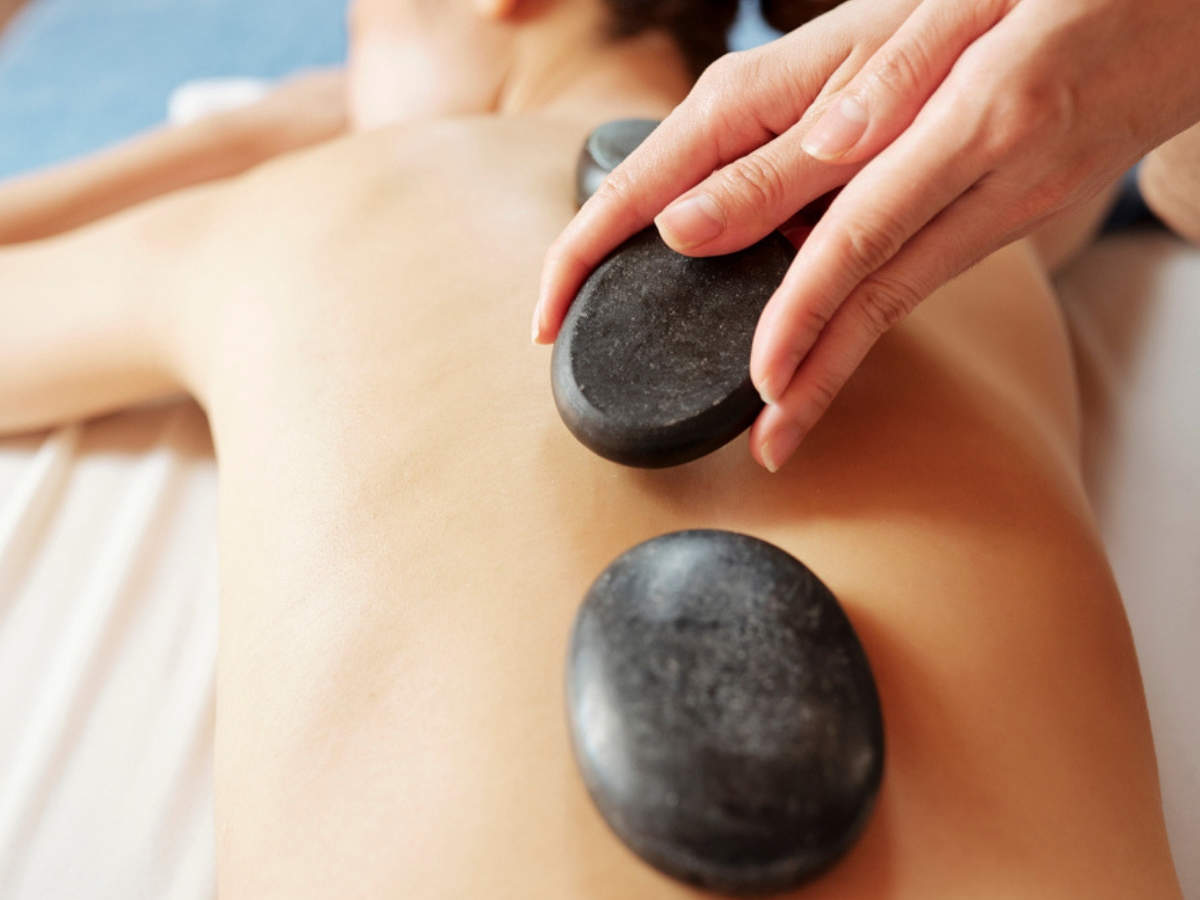 Step-by-step guide to hot stone massage at home - Times of India