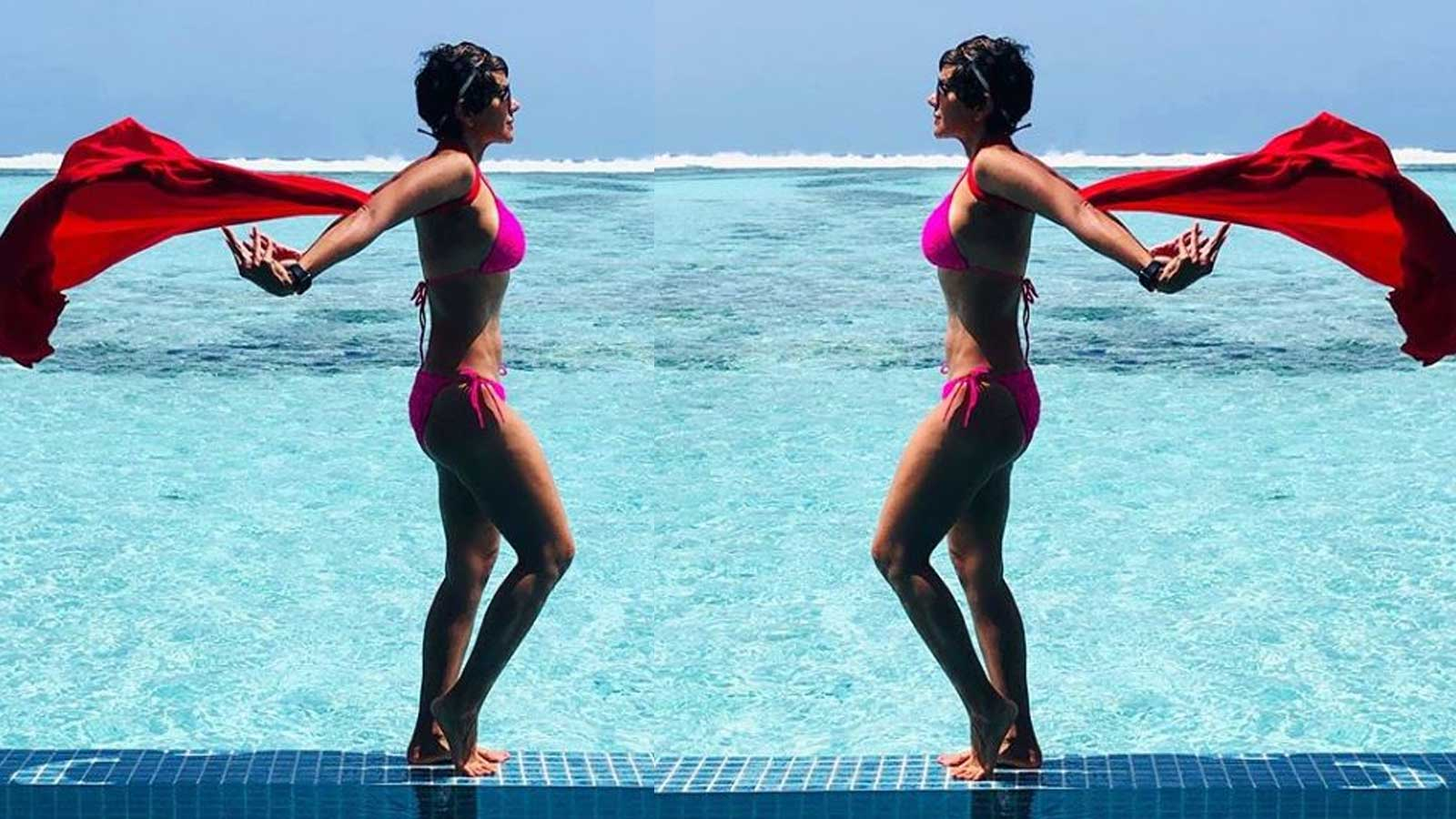 mandira-bedi-turns-superhero-in-a-pink-bikini-flaunts-her-washboard-abs