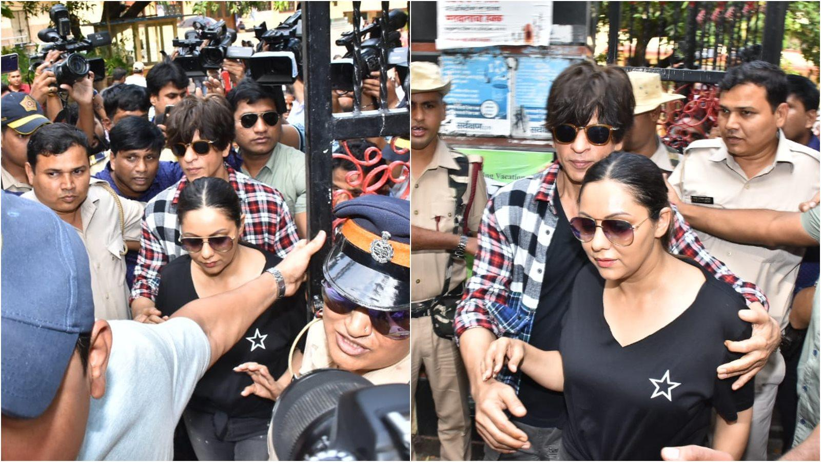 shah-rukh-khan-turns-bodyguard-for-wife-gauri-khan-as-they-get-mobbed-outside-polling-booth