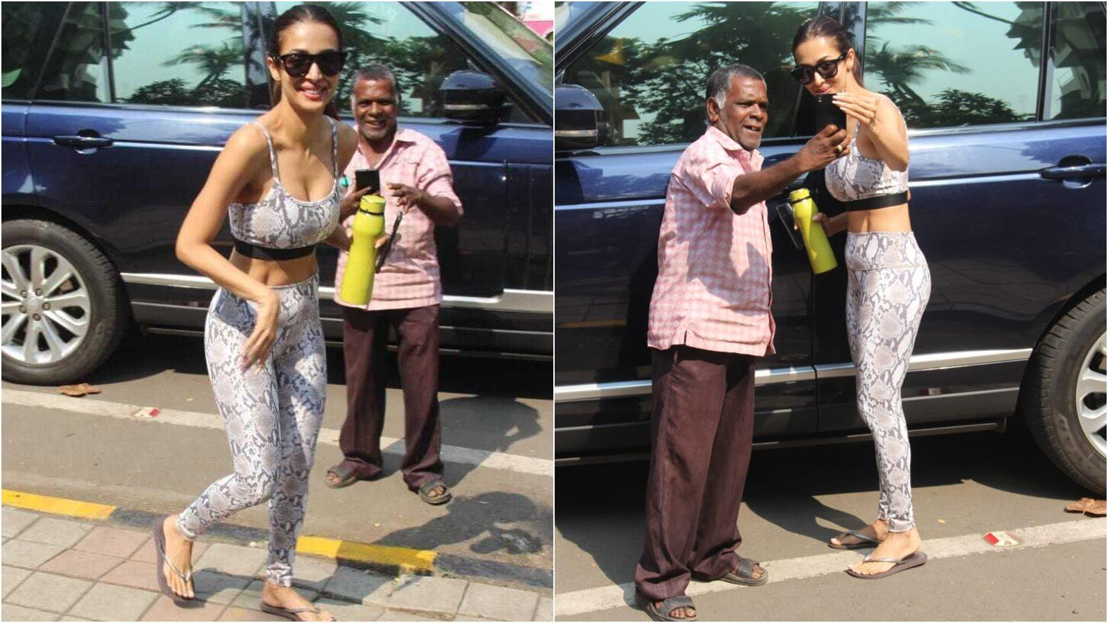 malaika-arora-makes-an-elderly-fan-happy-as-she-stops-by-for-a-selfie-on-her-way-to-the-gym