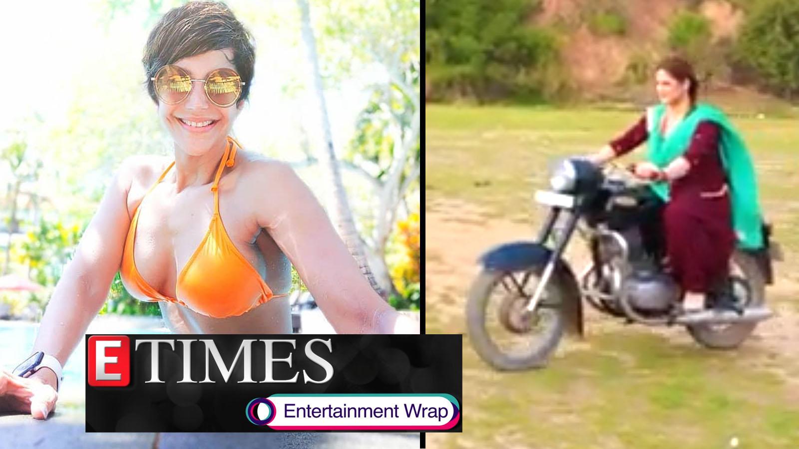 mandira-bedi-flaunts-incredibly-toned-figure-in-orange-bikini-zareen-khan-rides-motorcycle-like-a-pro-and-more