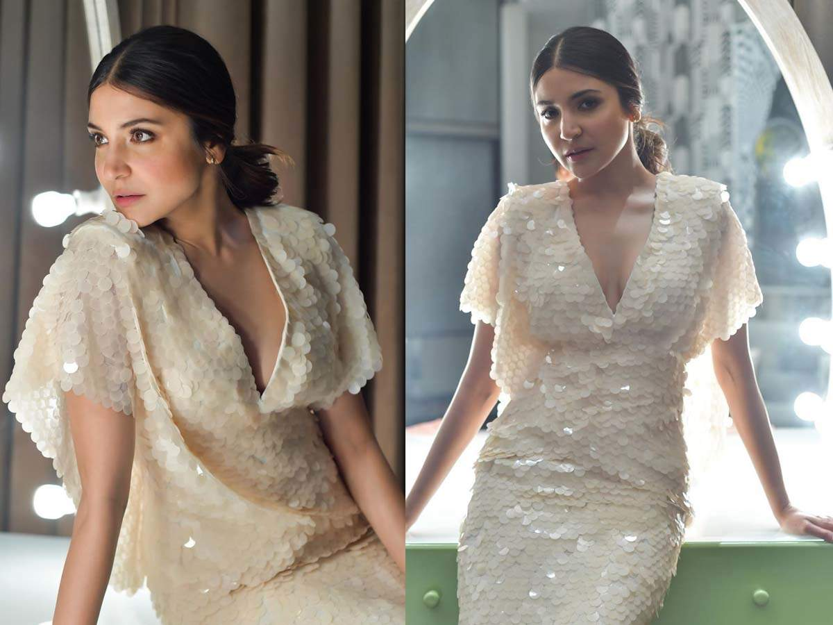 We can't help but fall in love with these pictures of Anushka Sharma in a white sequined ensemble! thumbnail