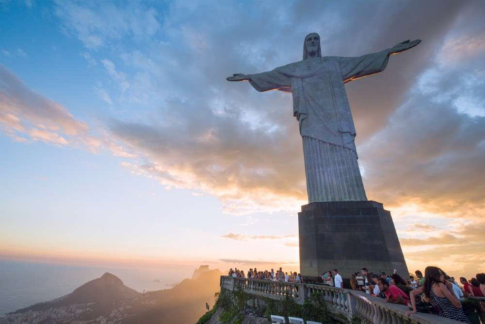 Statue of Christ the Redeemer in Brazil lit up with the flags of countries hit by COVID 19