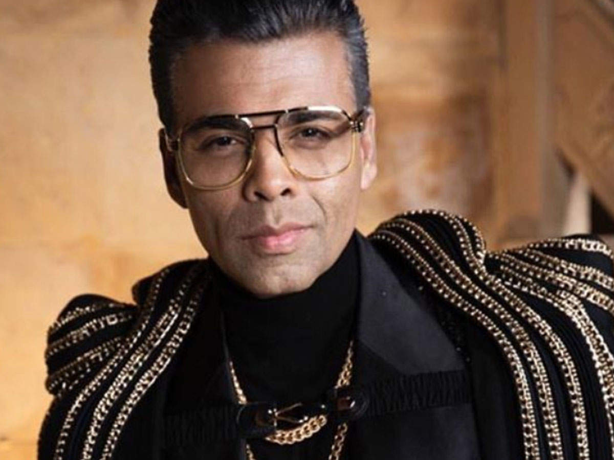 Karan Johar shows off his new salt and pepper look in a cool ...