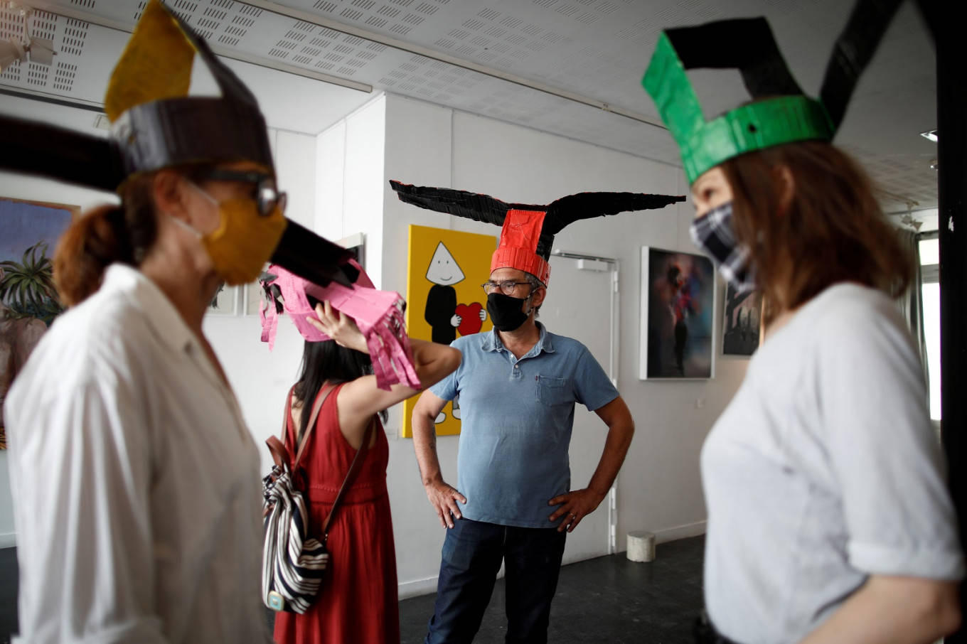 Special hats in this Paris art gallery will help maintain social distancing